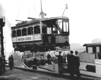 Lower deck of Glasgow Tram 488 leaving Scotland via the River Clyde
